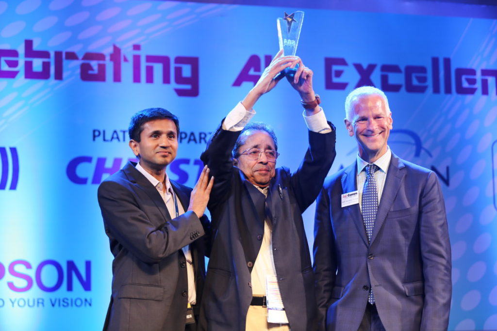 "Manmohan Gupta, Founder of Actis Technologies, presented with the Lifetime Achievement Award for ""The Most Distinguished Visionary in Systems Integration in India."" Presenting the award was David Labuskes, Executive Director and CEO of InfoComm International. At the side of Mr Gupta, is his son Abhimanyu"