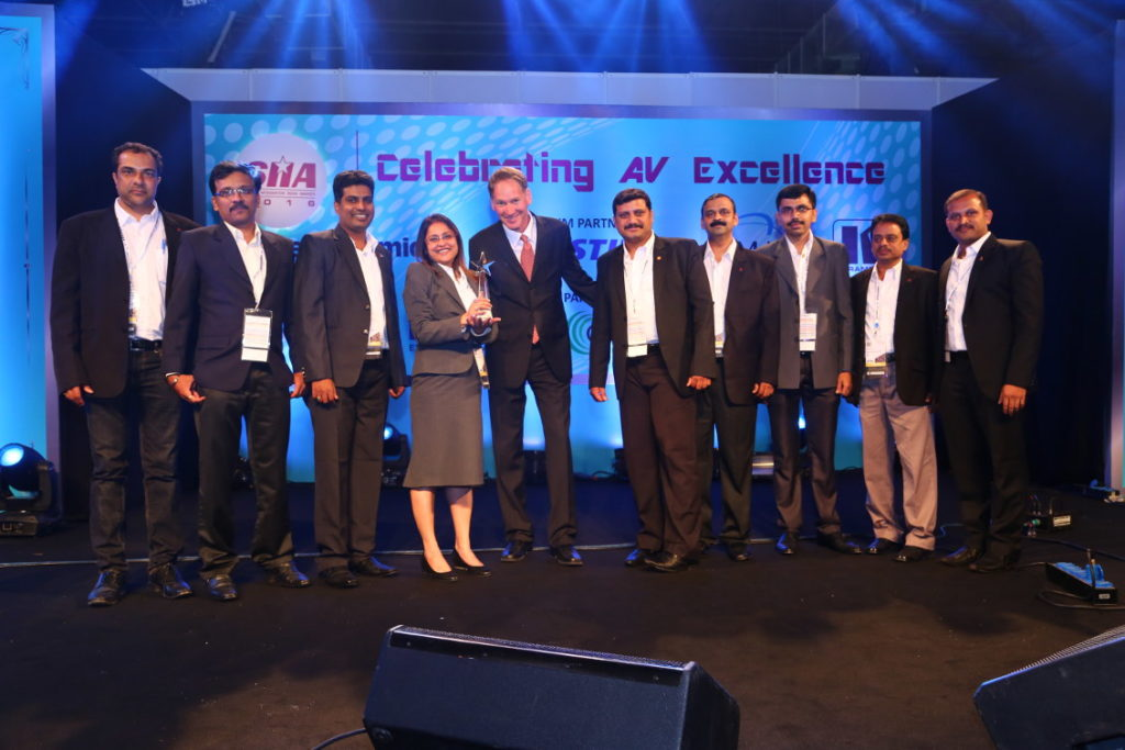 AVID with the award for Corporate category, with the premium budget range of ₹ 10 Cr and above. Aviv Ron (centre in tie) of Kramer presented the award